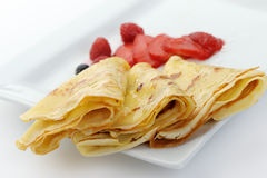 Crepe on a plate with a strawberry Royalty Free Stock Photography
