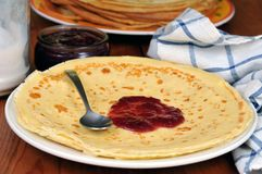 Crepe on a plate with strawberry jam royalty free stock photos