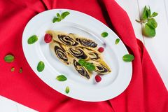 Crepe Poppy Filling Pancake Week Breakfast Flatlay. European Shrovetide Healthy Food Thin Slice Dessert with Raspberry and Mint on Red Tablecloth Top Down View royalty free stock photography