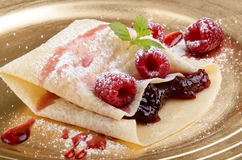 Crepe with raspberries and jam Royalty Free Stock Images