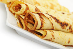 Crepe roll up a tubule on a plate Royalty Free Stock Photography