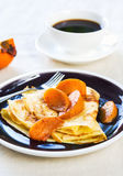 Crepe with sauteed persimmon Stock Photo