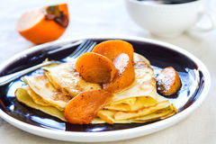 Crepe with sauteed persimmon Royalty Free Stock Photography