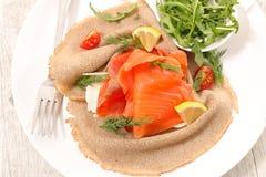 Crepe with smoked salmon stock image