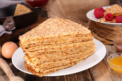 Crepe. Stack of crepe on wood background stock photography