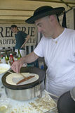 Crepe Stand with man making crepe at the Flea Market, Paris, France Royalty Free Stock Photos