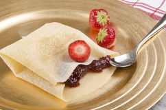 Crepe with strawberries and jam Royalty Free Stock Image