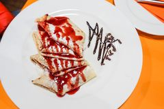 Crepe with Strawberry Sauce stock image