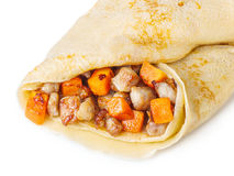 Crepe stuffed with meat closeup. Thin crepe (pancake) stuffed with fried pork and carrot Royalty Free Stock Photos