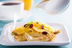 Crepe suzette with orange cranberry sauce Stock Photography