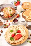 Crepe and waffles. Table with crepe, waffle and pancake stock photos