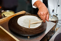 Creperie buffet. Preparing a crepe in a party Royalty Free Stock Photos