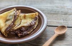 Crepes с сливк шоколада Стоковое Изображение