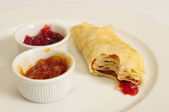 Crepe / Crepes / Pancake / Pancakes 13. This close-up picture shows some crepes with jam on a plate Royalty Free Stock Image