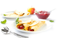 Crepes. With red fruit compote on a white plate Stock Photography