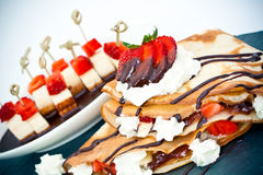 Crepes. Filled with fresh strawberries and whipped cream topped with chocolate Royalty Free Stock Photo