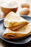 Crepes. Close up of two french style crepes, shallow dof. Some ingredients in the background Royalty Free Stock Photo