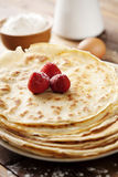 Crepes. Close up of two french style crepes, shallow dof. Some ingredients in the background Royalty Free Stock Images