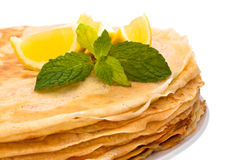 Crepes. Stack of homemade crepes on the plate, isolated on white background. A crepe is a type of very thin pancake. It is very popular in France. Crepe may Stock Photography