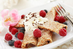 Crepes. Filled with chocolate and fruits Royalty Free Stock Images