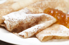 Crepes. Close up of crepes with powdered sugar and jam Stock Photo