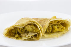 Crepes with apples. Crepes (pancakes) stuffed with grated apple and cinnamon Royalty Free Stock Photography
