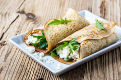 Crepes with arugula and cheese. Burrito style stock image
