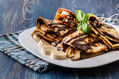 Crepes with banana and chocolate cream Stock Photo