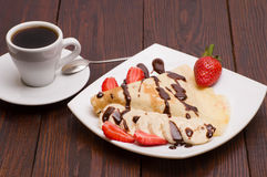 Crepes with Banana and strawberries Royalty Free Stock Photo