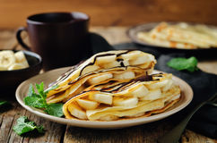 Crepes with banana. On a wood background. toning. selective focus Royalty Free Stock Image