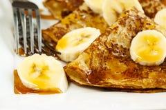 Crepes With Bananas and Caramel syrup close up Royalty Free Stock Image
