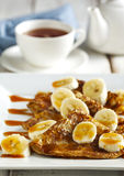 Crepes With Bananas and Caramel syrup Stock Photography