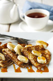 Crepes With Bananas and Caramel syrup Royalty Free Stock Photos