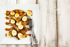 Crepes With Bananas and Caramel syrup Royalty Free Stock Image
