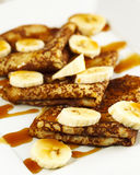 Crepes With Bananas and Caramel syrup Royalty Free Stock Photography