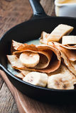 Crepes with bananas and  cream caramel sauce Stock Image