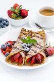 Crepes with berries and chocolate sauce for breakfast, vertical Royalty Free Stock Images