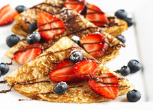 Crepes With Berries and Chocolate topping Royalty Free Stock Photo