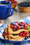 Crepes with berries Stock Photography