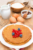 Crepes with berries and ingredients for baking Royalty Free Stock Image
