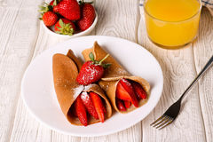 Crepes with berries and orange juice, horizontal, top view royalty free stock photography