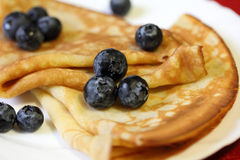 Crepes with berries. Pancakes or crepes with berries, macro Royalty Free Stock Photo