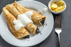 Crepes with black caviar Royalty Free Stock Photography