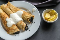 Crepes with black caviar Royalty Free Stock Photos