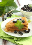 Crepes with black currant stock photos