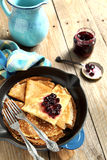 Crepes with black currant Royalty Free Stock Image