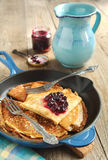 Crepes with black currant Royalty Free Stock Images