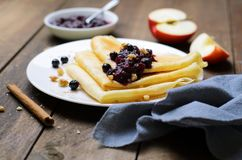 Crepes with Black Currant Jam on Dark Wooden Background stock images