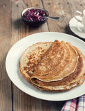 Crepes with black currant jam royalty free stock images