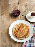 Crepes with black currant jam Stock Images
